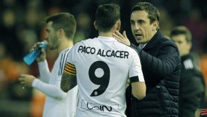Gary Neville (right) speaks with his new Valencia captain Paco Alcacer